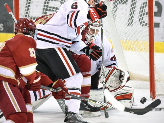 St. Cloud State Goaltender David Hrenak watches as
