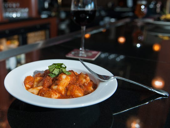 A  Ricotta Cheese Gnocchi Bolognese dish is offered at Giumarello's Restaurant & G Bar.