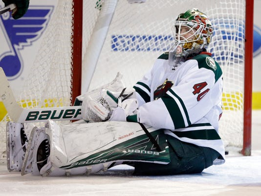 Minnesota Wild goalie Devan Dubnyk sits on the ice after giving up a goal to St. Louis Blues' Jori Lehtera, of Finland, during the second period of an NHL hockey game Saturday, Feb. 6, 2016, in St. Louis. (AP Photo/Jeff Roberson)