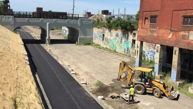 Crews have recently laid the blacktop for the Dequindre Cut extension.