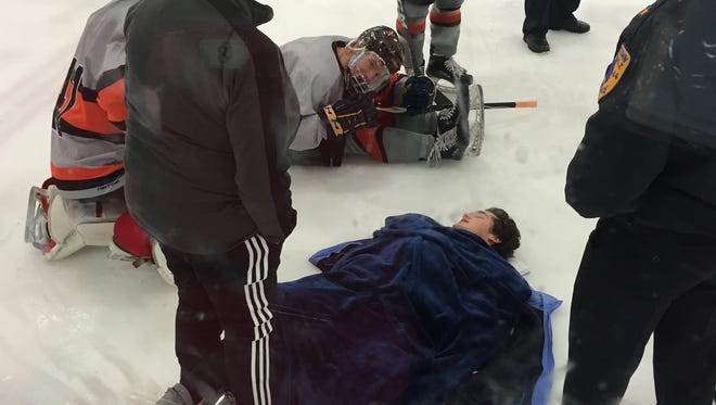 Michael Grazioso was brought blankets, as the Middletown North sophomore suffered a lower body injury on Tuesday at Middletown Ice World and laid on the ice for 47 minutes until an ambulance arrived to transport him to the hospital.