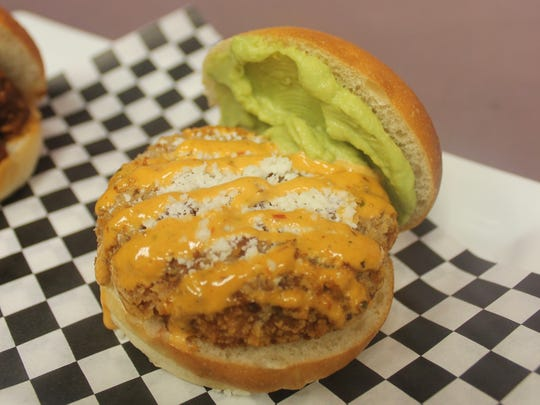 A vegetarian black bean and corn fritter slider from Chef's Mobile Kitchen.