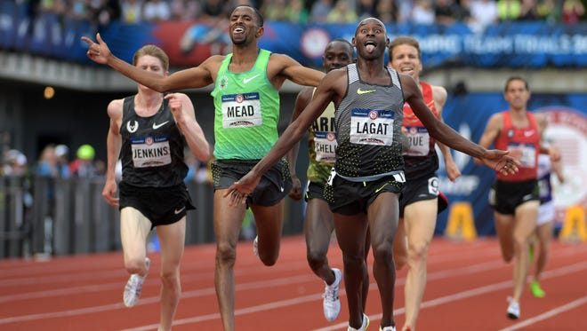 Bernard Lagat crosses the line first in the 5000 meters on Saturday, ahead of Hassan Mead. The 41-year-old Lagat will compete in his fifth Olympics.