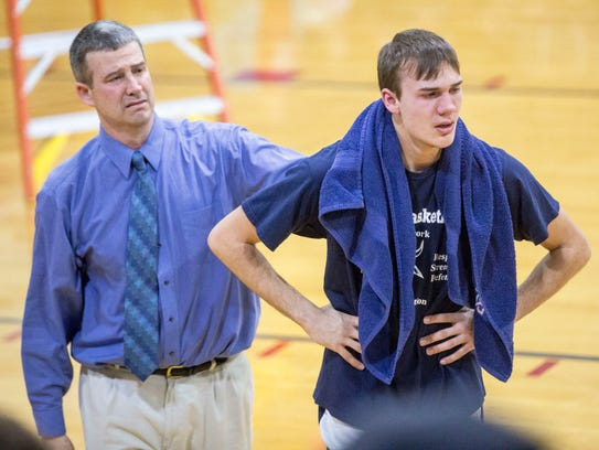Trey Klein is comforted by his dad and coach Brian