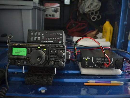A radio receiver set up in a pickup bed. Hams are far more mobile than commercial operators, who rely more heavily on the electrical grid. A small generator, or a solar array, will do the trick for amateur operators.
