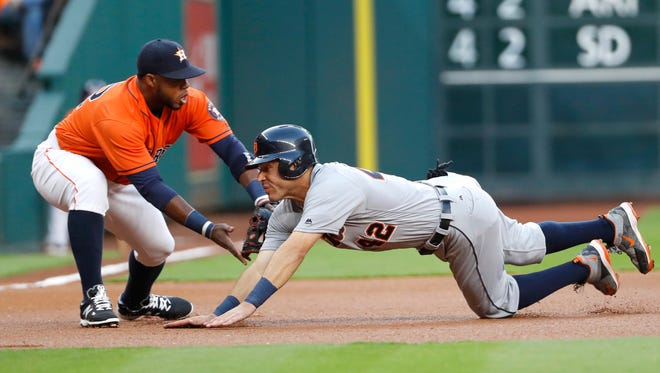 Detroit Tigers' Ian Kinsler, right, is tagged out by Houston Astros third baseman Luis Valbuena during the first inning Friday.