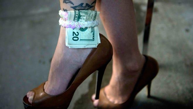 A dancer at a strip club.
