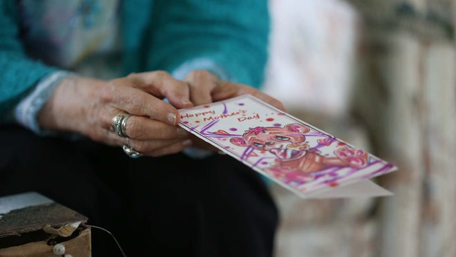 Jean Basinger, of Des Moines, talks about her experiences writing letters to people in prison, on Wednesday, May 6, 2015. She has been sent a variety of letters and cards over the years; recently she was sent this Mother's Day card. Basinger has been writing letters to people in prison and has been an advocate for prison reform for many years.