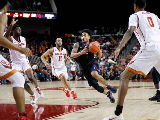 Washington's David Crisp drives toward the basket past Southern California players during the first half of an NCAA college basketball game, Saturday, March 4, 2017, in Los Angeles. (AP Photo/Jae C. Hong)