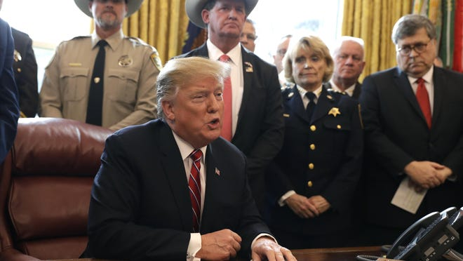 President Donald Trump speaks about border security in the Oval Office of the White House, Friday, March 15, 2019, in Washington.