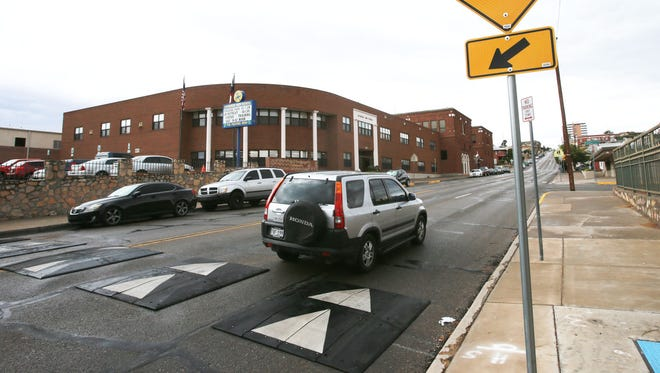 A vehicle heads north on Stanton Street after going over speed humps that had been placed in front Cathedral High School. They were later removed.