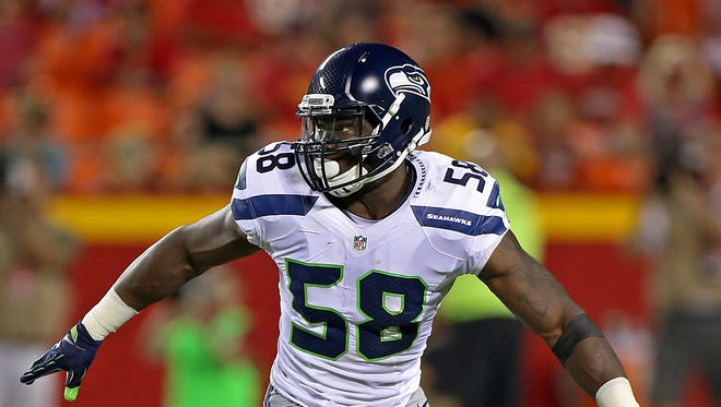 Seattle Seahawks linebacker Kevin Pierre-Louis (58) drops into coverage during an NFL game against the Kansas City Chiefs on Friday Aug. 21, 2015 at Arrowhead Stadium in Kansas City, Mo.