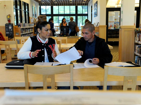Johnny Placencia helps Marina resident Luz Munguia with a legal matter at the Marina Public Library.