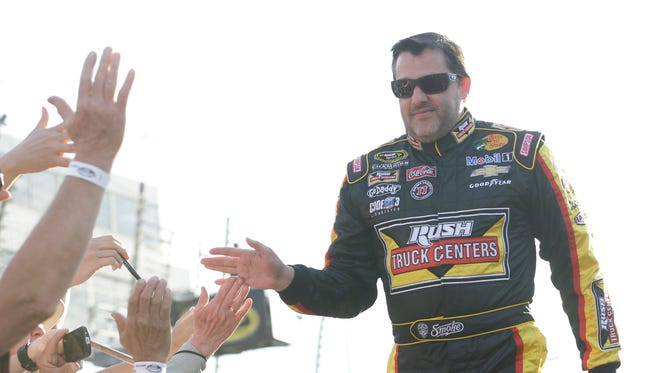 Sprint Cup driver Tony stewart greets fans during driver introductions prior to the NASCAR Sprint Cup Auto race at Richmond International Raceway in Richmond, Va., April 26, 2014.