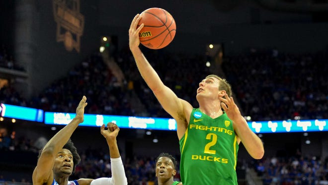 Mar 25, 2017: Oregon Ducks guard Casey Benson (2) goes up for a shot as Kansas Jayhawks guard Josh Jackson (11) guards during the first half in the finals of the Midwest Regional of the 2017 NCAA Tournament at Sprint Center.