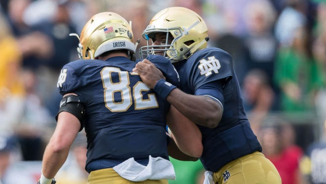 Notre Dame Fighting Irish quarterback Brandon Wimbush (7) and tight end Nic Weishar (82) celebrate after a touchdown in the first quarter against the Temple Owls at Notre Dame Stadium.