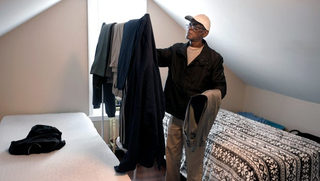 Dwayne McCord, 64, stands at his bed with his few belongings at the Franklin Community House on Natchez Street in Franklin on Nov. 14, 2017.  He isthe first of eight residents in a men's group home started in Sep. 2017 by pastor Kevin Riggs which is designed to help men find transitional housing in Franklin.