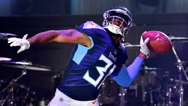 Tennessee Titans safety Kevin Byard (31) shows off the new Titans uniform during a block party downtown Nashville on Wednesday, April 4, 2018.
