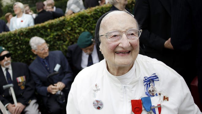 In this file photo taken on Aug. 19, 2012 sister and former nurse Marie-Agnes Valois takes part in the 70th anniversary ceremony of the Dieppe Raid in Dieppe, northwestern France, in memory of the Second World War Allied attack on the German-occupied port of Dieppe on August 19, 1942.