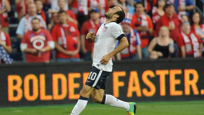 United States midfielder Landon Donovan (10) reacts after missing a shot on goal during the first half of the match against Jamaica at Sporting Park. The United States won 2-0. Mandatory Credit: Denny Medley-USA TODAY Sports