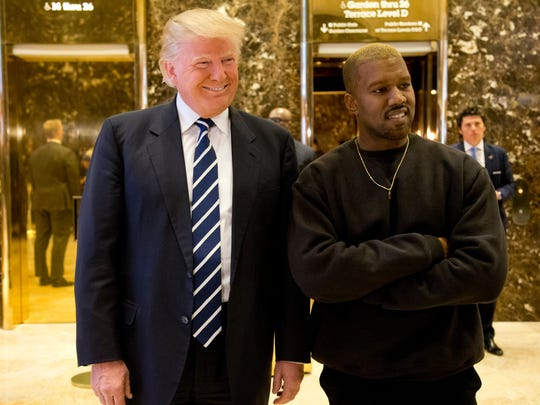 President-elect Trump, left, and Kanye West pose for
