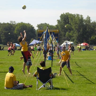 Jenna Wentland, of Sterling Heights, hits the ball over the net Sunday, July 26, during the annual Volleygrass volleyball tournament at Port Huron Northern.