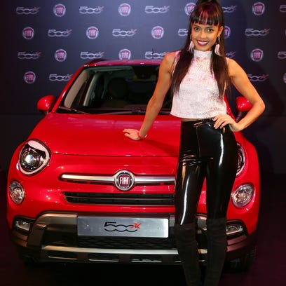 A model poses with the Fiat 500X in London