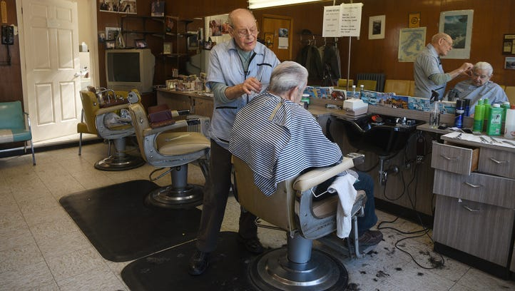 Ozzie gives Calogero Zaccone, 92 his last haircut on