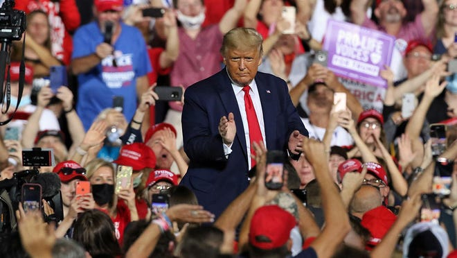 President Donald Trump is surrounded by thousands of supporters as he departs the stage Wednesday evening, Oct. 21, 2020, as he held a rally outside under the stars at the Gastonia Municipal Airport on Gaston Day School Road.