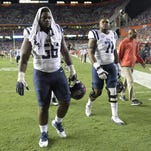 Ole Miss defensive tackle Woodrow Hamilton (56) and offensive lineman Christian Morris (71) leave the field after last week's loss at Florida.