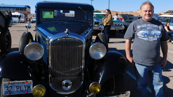 Don Williams stands next to his 1932 Plymouth, which he displayed at Mesquite Motor Mania earlier this month.