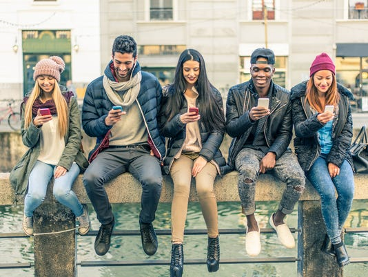 Group of people with cellphones