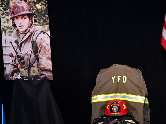 Ivan Flanscha's helmet and turnout gear are displayed