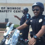 Monroe Police Cpl. Maynor Gray and Officer Gabriel Smith help unveil six new Segways which will be used for police efforts throughout downtown and during community events.