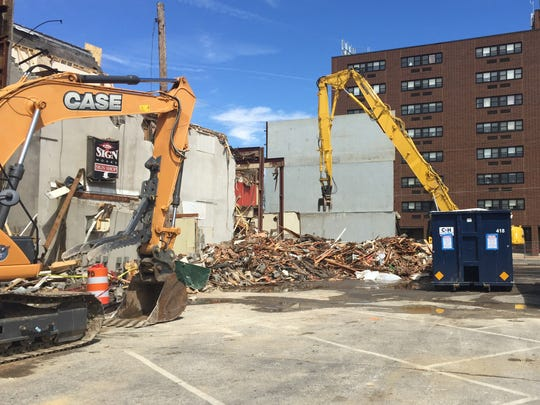 The view of the demolition site at 109 East Main Street in Millville, early Monday.