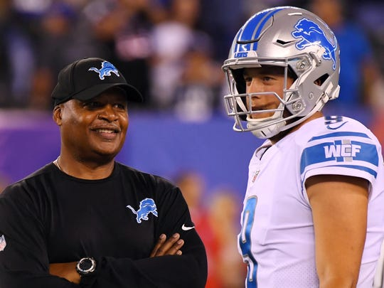 Lions coach Jim Caldwell with quarterback Matthew Stafford (right) before a game against the Giants at MetLife Stadium on Monday, Sept. 18, 2017.