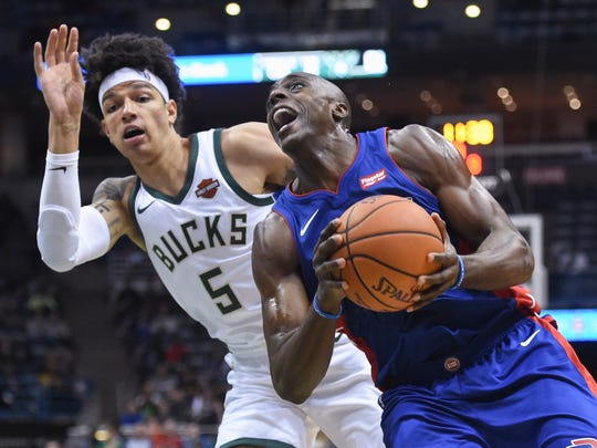 Pistons forward Anthony Tolliver (43) drives for the basket against Bucks forward D.J. Wilson (5) in the second quarter of the Pistons' 107-103 exhibition loss on Friday, Oct. 13, 2017, in Milwaukee.