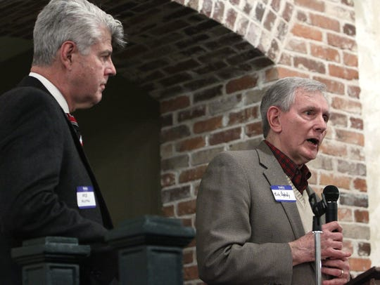 Dr. Bob Austin, left, listens to Kirk Oglesby, past