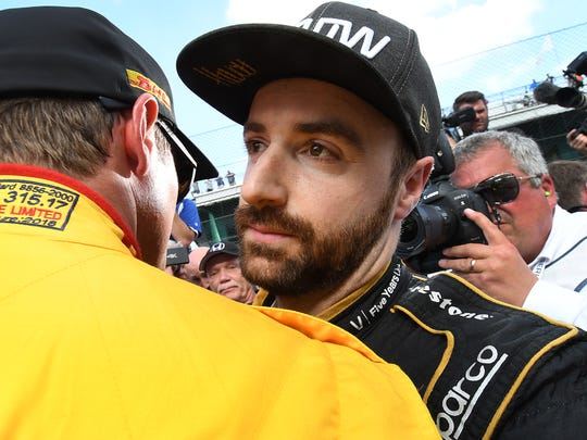 Schmidt Peterson Motorsports IndyCar driver James Hinchcliffe (5) gets a hug by driver Ryan Hunter-Reay after he failed to make the field of 33 cars on qualification day for the Indianapolis 500 at the Indianapolis Motor Speedway on Saturday, May 19, 2018.