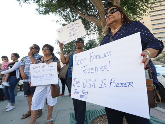 About 100 people participate in an immigration rally