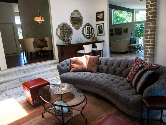 Neutral furniture with colorful accents decorate Susan and Chris's living room in Indian Hill Tuesday, June 6, 2017.