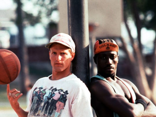 "Woody Harrelson and Wesley Snipes in the film ""White Men Can't Jump."""