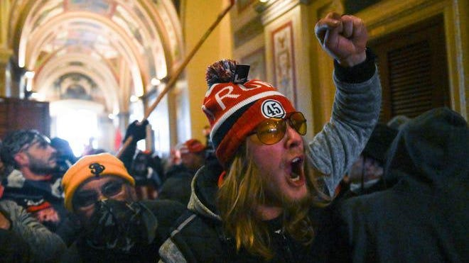 Supporters of US President Donald Trump protest inside the US Capitol on January 6, 2021, in Washington, DC. - Demonstrators breached security and entered the Capitol as Congress debated the 2020 presidential election Electoral Vote Certification.