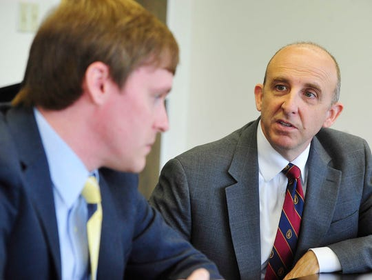 Justin Owen, left, president and CEO of the Beacon
