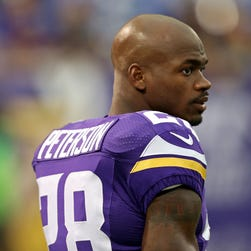 Minnesota Vikings running back Adrian Peterson (28) looks on during pre game before a game against the Houston Texans at the Metrodome.