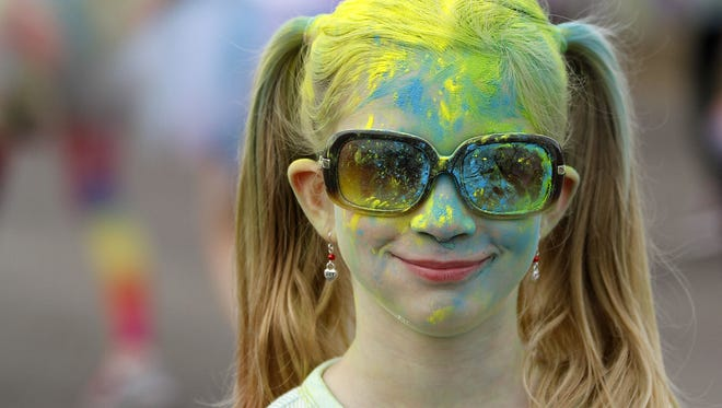 Kaelyn Golden pauses for a photo during the Color Vibe 5K 2014 at the Oregon State Fairgrounds. The run returns July 30.