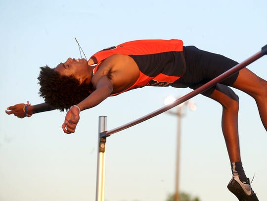 Blackman's Emilio Martin clears the high jump bar at