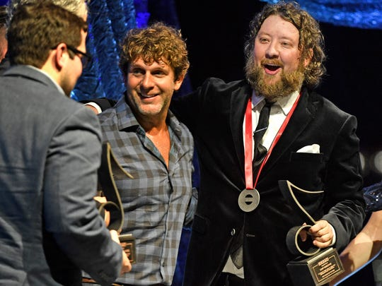 Cary Barlowe, right, is joined by Billy Currington, after ÒIt DonÕt Hurt Like It Used To,Ó was named SESAC Song of the Year at the 2017 SESAC Music Awards