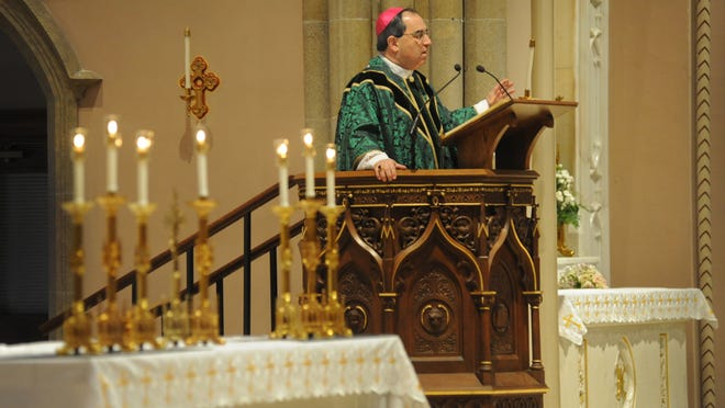 Bishop Michael Duca speaks at The Cathedral of St. John Berchmans.