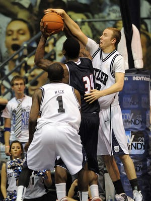 #30 Butler center Emerson Kampen applies pressure on #34 UIC forward Paris Carter along with #1 Butler guard Shelvin Mack during the second half of the college basketball game at Hinkle field house in Indianapolis, Ind.  Butler won 72 to 65.  Monday Feb. 7, 2011.
